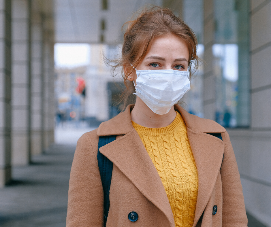 lady with mask covering mouth and nose